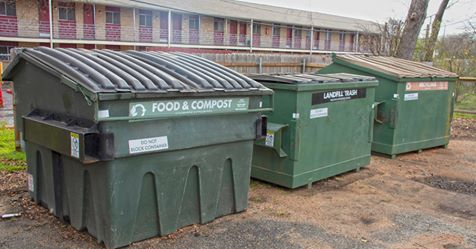 multifamily composting dumpster pictured with trash and recycling dumpsters