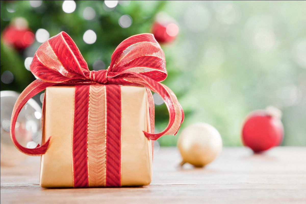 Image of a wrapped gift under a tree.