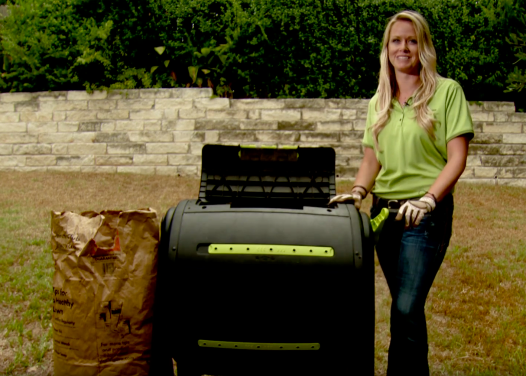 Woman with home composting tumbler