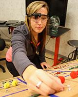 Student demos eye tracking at COSI