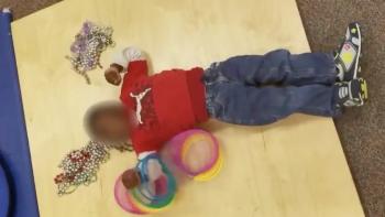 A boy lying on his back on a resonance board