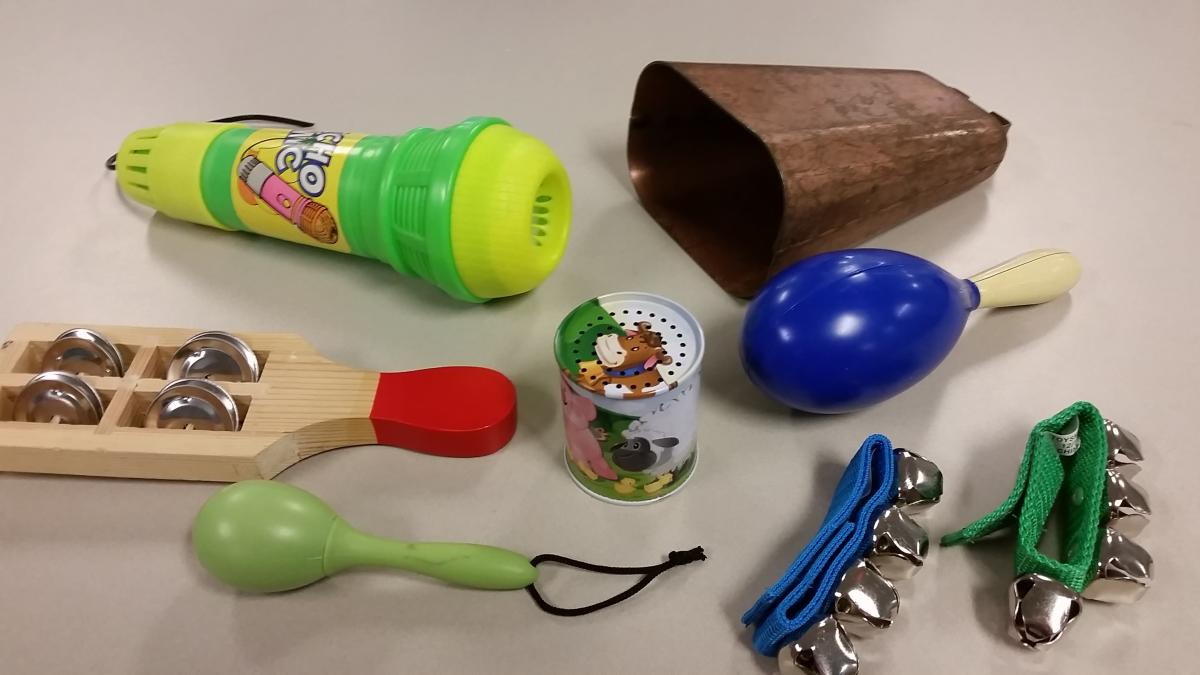 Noisy items, including cowbell, microphone, tambourine, bells