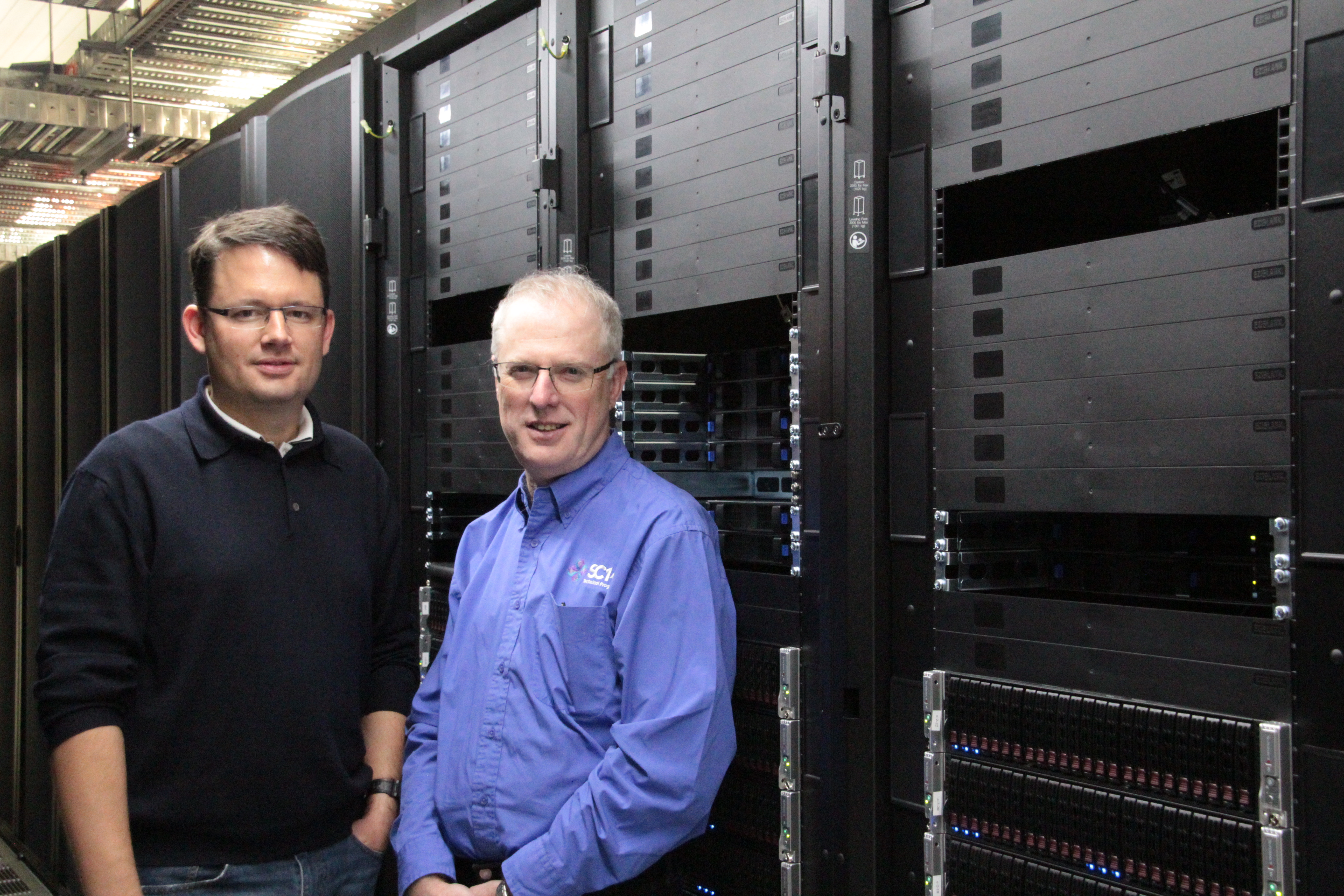 XENON Chief Technology OfficerWerner Scholz and RCC Director Prof David Abramson with FlashLite at its base in Brisbane.
