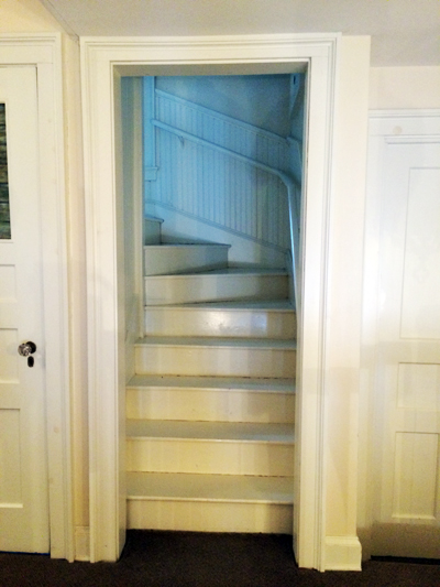 [the stairs leading up to the attic room]