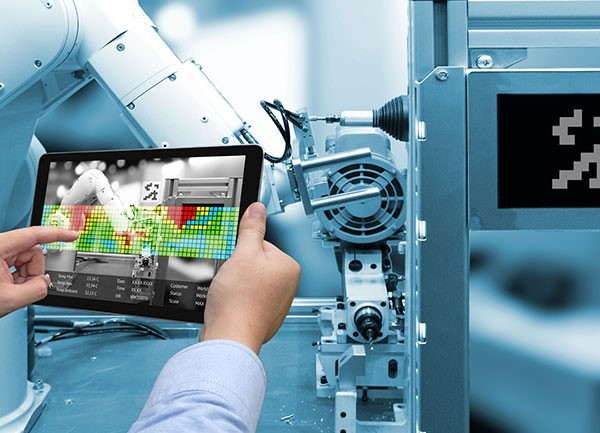 Hands holding tablet with digital manufacturing software