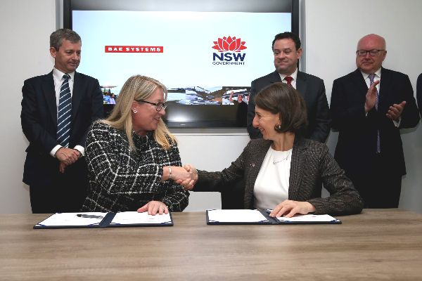 Ms Gabby Costigan and Premier Gladys Berejiklian shaking hands