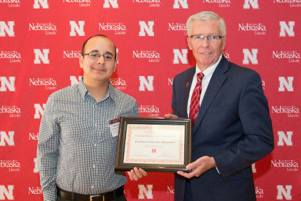 Esteban Bogantes receives his Widaman Distinguished Graduate Assistant Award from Dean Archie Clutter