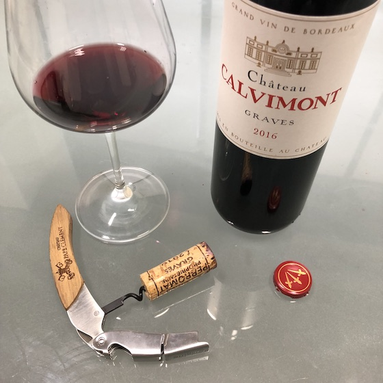 Chateau Calvimont bottle, corkscrew, and glass