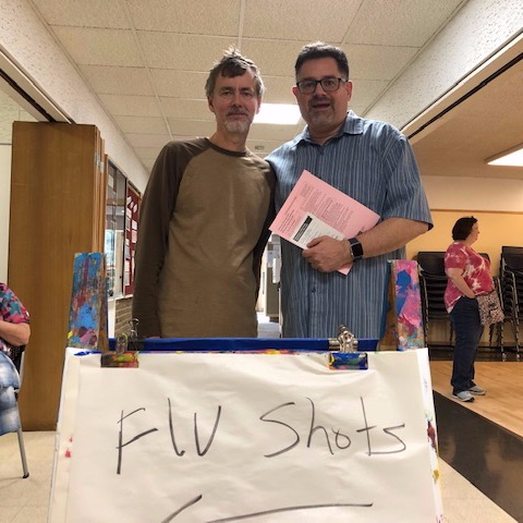 Brian and Rev. Eric  with Flu Shot sign
