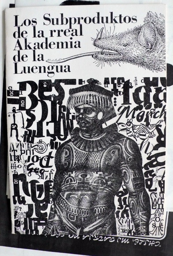 "The words ""Los Subproduktos de la rreal Akademia de la Luengua"" and a person covered in tribal tattoos, with letters and images in the background."