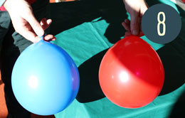 Two balloons, one red and one blue.