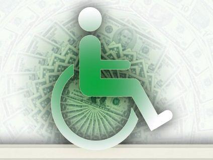wheelchair icon with dollar bills behind it