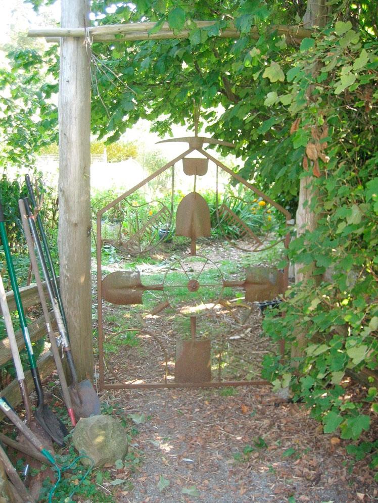 Garden Art Gate Shovels Rakes