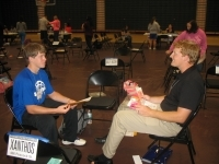 Students at the University of Saint Francis participate in a Poverty Simulation.