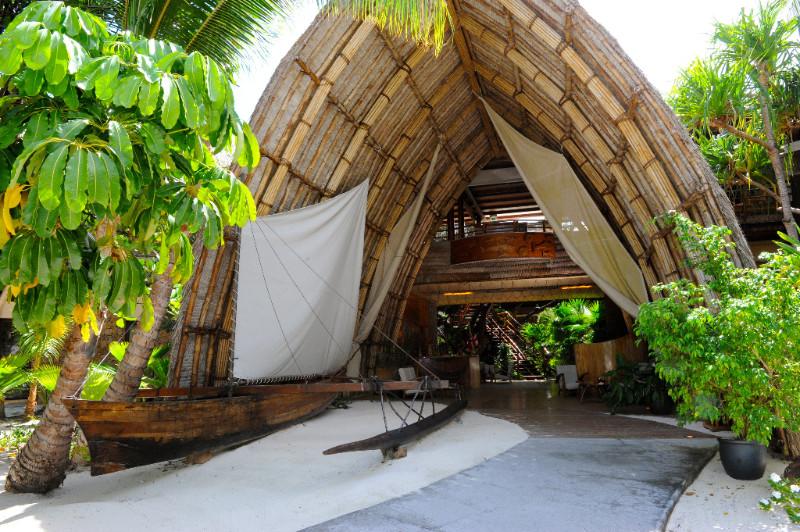 Traditional polynesian outrigger canoe at Le Tahaa Resort
