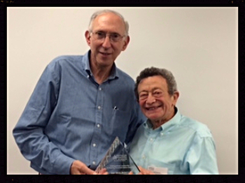 Photo of Jerry Bergman, President HLAANY and Sid Wolinsky with his award
