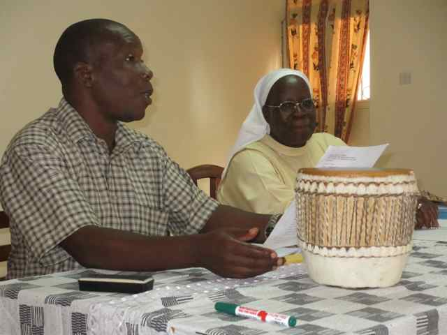 Dr Paddy Musana welcoming Sister Anne Nasimiyu-Wasike
