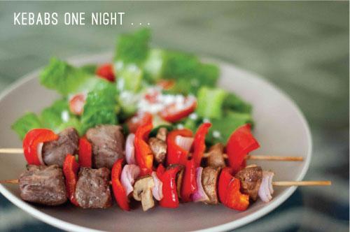 Steak kebabs with greek salad