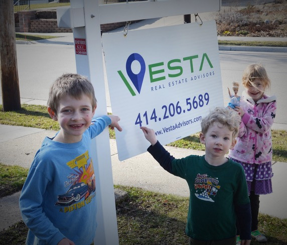 Children with Realetate Sign