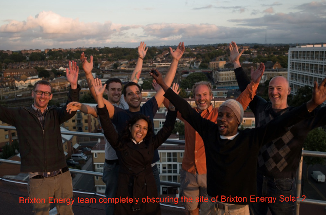 Brixton Energy team in ebullient mood obscuring the roofs of Styles Gardens where the solar panels will be installed.