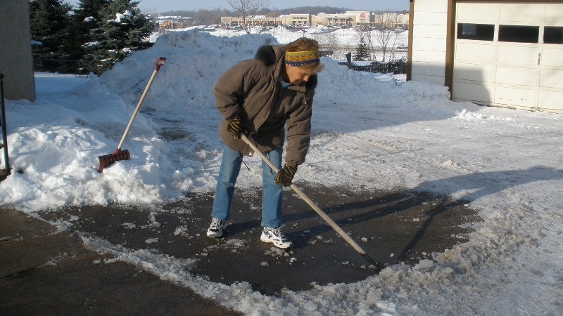 Clearing ice off driveway