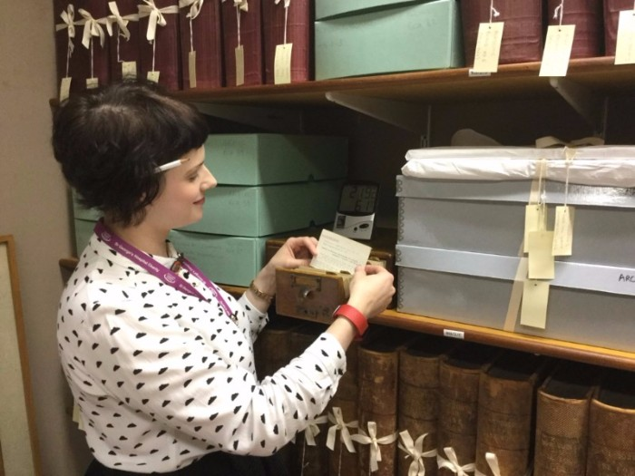 Elisabeth working as a lone archivist in 2016