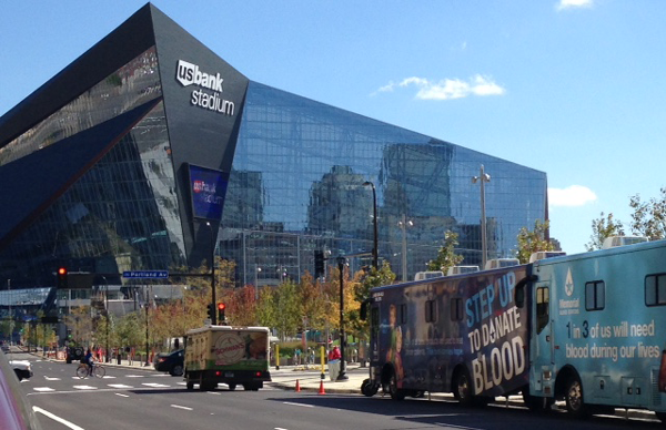 MBC bloodmobiles in front of the US Bank Stadium