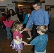 Picture of Father and two children participating in a family dance workshop