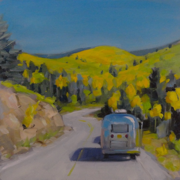 airstream traveling through santa fe ski area in the fall