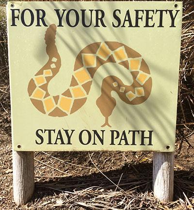 San Diego Safari Park signs warn visitors.