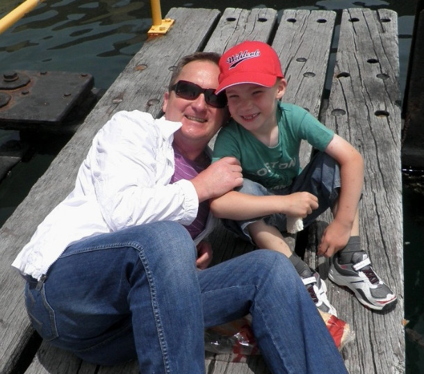 Arek Zoltowski & his young son on a jetty