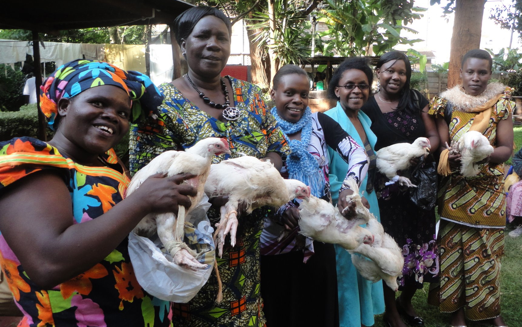 Some of the women in Kenya proudly show off their Christmas chickens