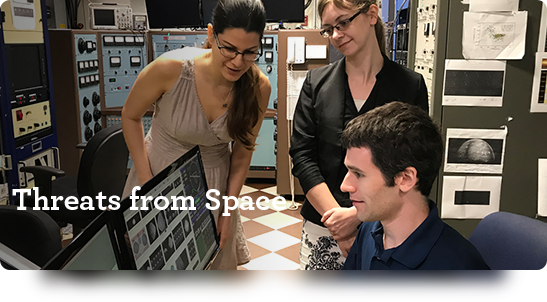 Threats from Space. Researchers huddled around computer monitors.