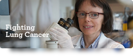 Fighting Lung Cancer. College of Medicine cancer researcher Dr. Alicja Copik behind a microscope