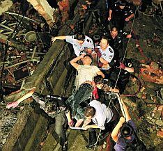 Oběti zřícené továrny v Číně