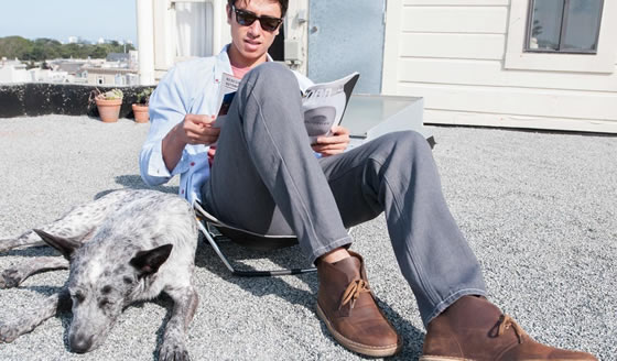 Rockslide Sons of Britches men's pants sit with a dog on a San Francisco roof