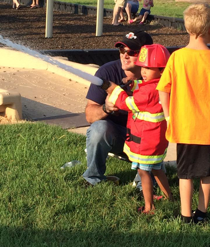 A future firefighter gets to try out the fire hose at this year's National Night Out.