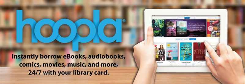 Hands holding a tablet and searching for titles through the app hoopla.