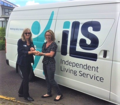 Kaz handing over the ILS Mobile Service keys to new ILS Mobile Manager Dee Kemp-Towns