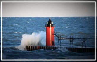 South Haven Lighthouse at sunrise with wave splashing