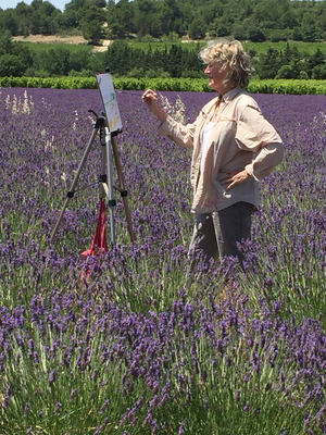 M.L. Porter Painting in a French lavender field