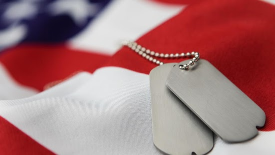 photo of a folded flag and dog tags