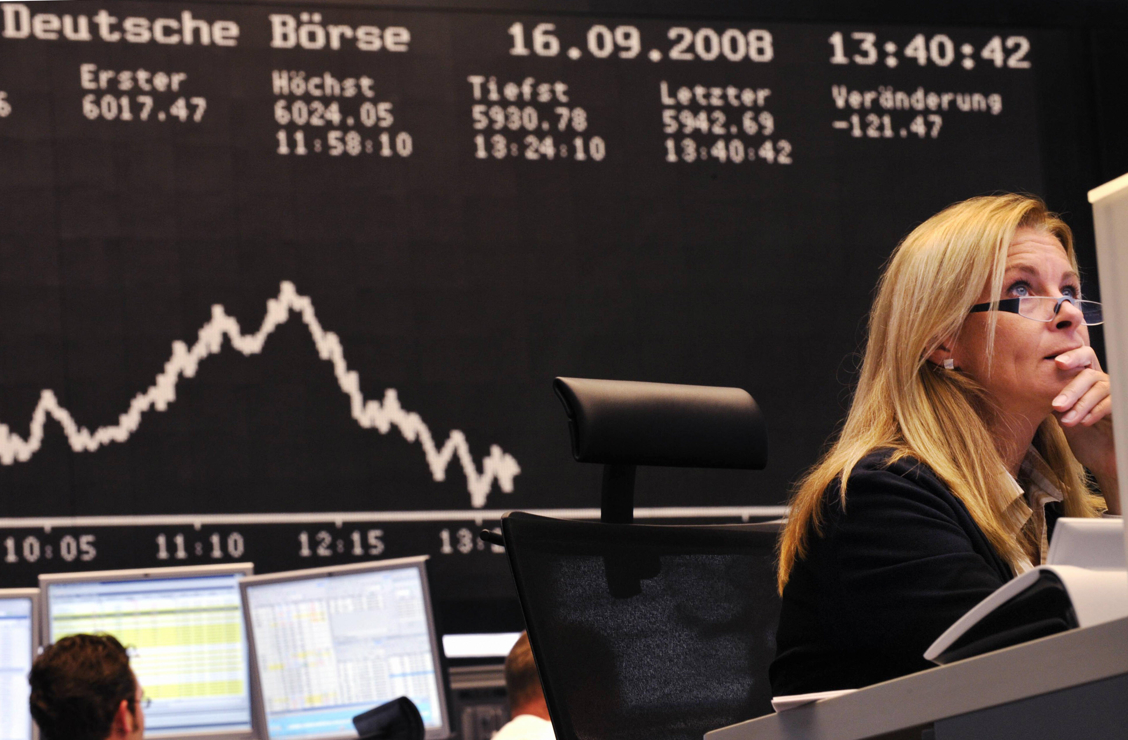 Stock brokers look at their screens at Frankfurt's stock exchange on Sept. 16, 2008, as the blue chip DAX 30 was down over three percent at 1300 GMT, adding to a 2.74 percent fall the day before after U.S. investment bank Lehman Brothers filed for bankruptcy protection. THOMAS LOHNES/AFP/Getty Images