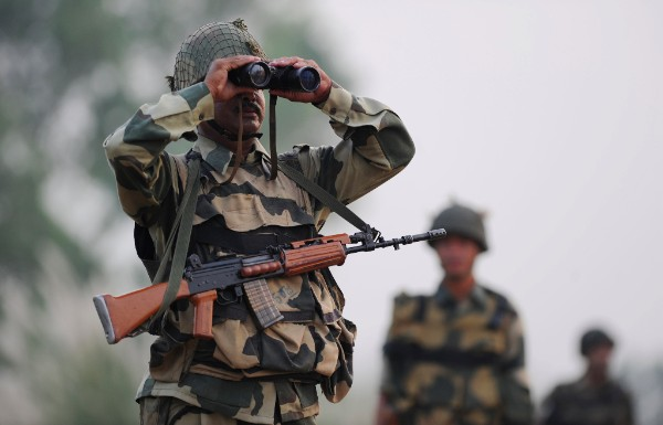 An Indian Border Security Force (BSF) soldier looks through binoculars towards Pakistan during a patrol at the India-Pakistan border southwest of Jammu, on Oct. 3, 2016. AUSEEF MUSTAFA/AFP/Getty Images