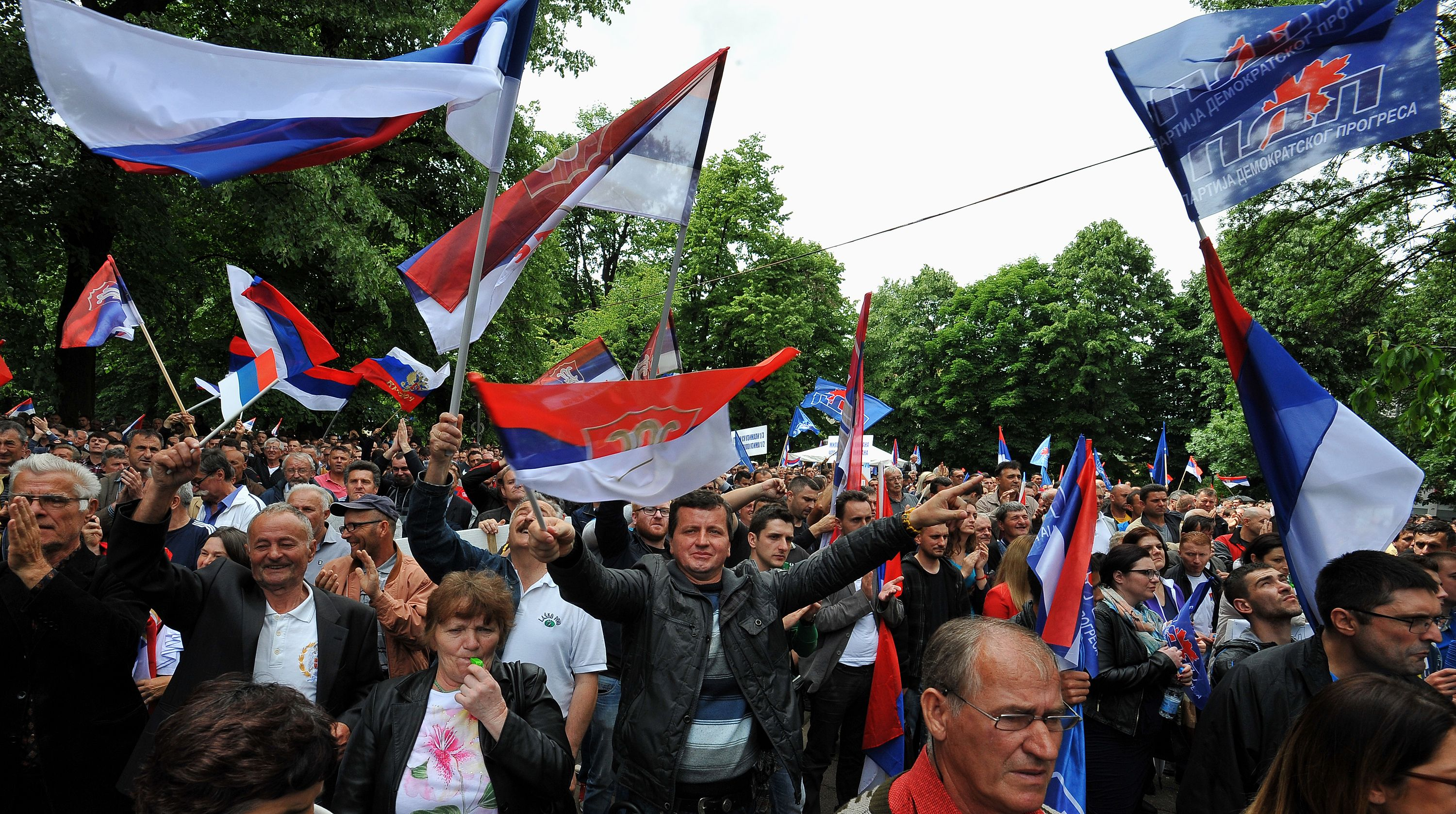 Bosnian-Serb supporters of right wing opposition parties wave flags during a protest on May 14, 2016 in Banja Luka. Thousands of opponents and supporters of Republika Srpska leader Milorad Dodik faced each other at simultaneous gatherings, accusing each other of corruption and treason. ELVIS BARUKCIC/AFP/Getty Images