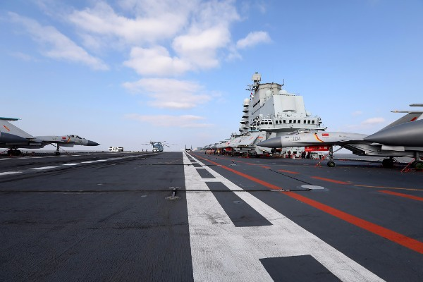 This photo taken on Dec. 23, 2016 shows Chinese J-15 fighter jets on the deck of the Liaoning aircraft carrier during military drills in the Yellow Sea, off China's east coast. Taiwan's defense minister warned on Dec. 27 that enemy threats were growing daily after China's aircraft carrier and a flotilla of other warships passed south of the island in an exercise as tensions rise. STR/AFP/Getty Images