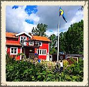 Vaxholm, Stockholm, resident raising the Swedish flag on Midsummer Eve