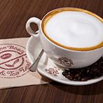 Coffee Bean & Tea Leaf company cappuccino cup, saucer, teaspoon and napkin photo