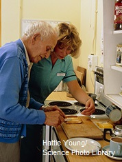 A man receiving occupational therapy to help him make breakfast