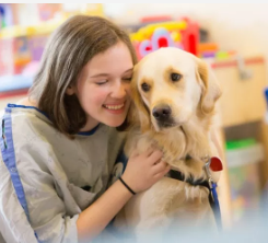 Girl with therapy dog